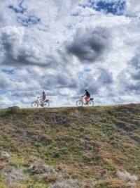 Dünen und Radfahrer